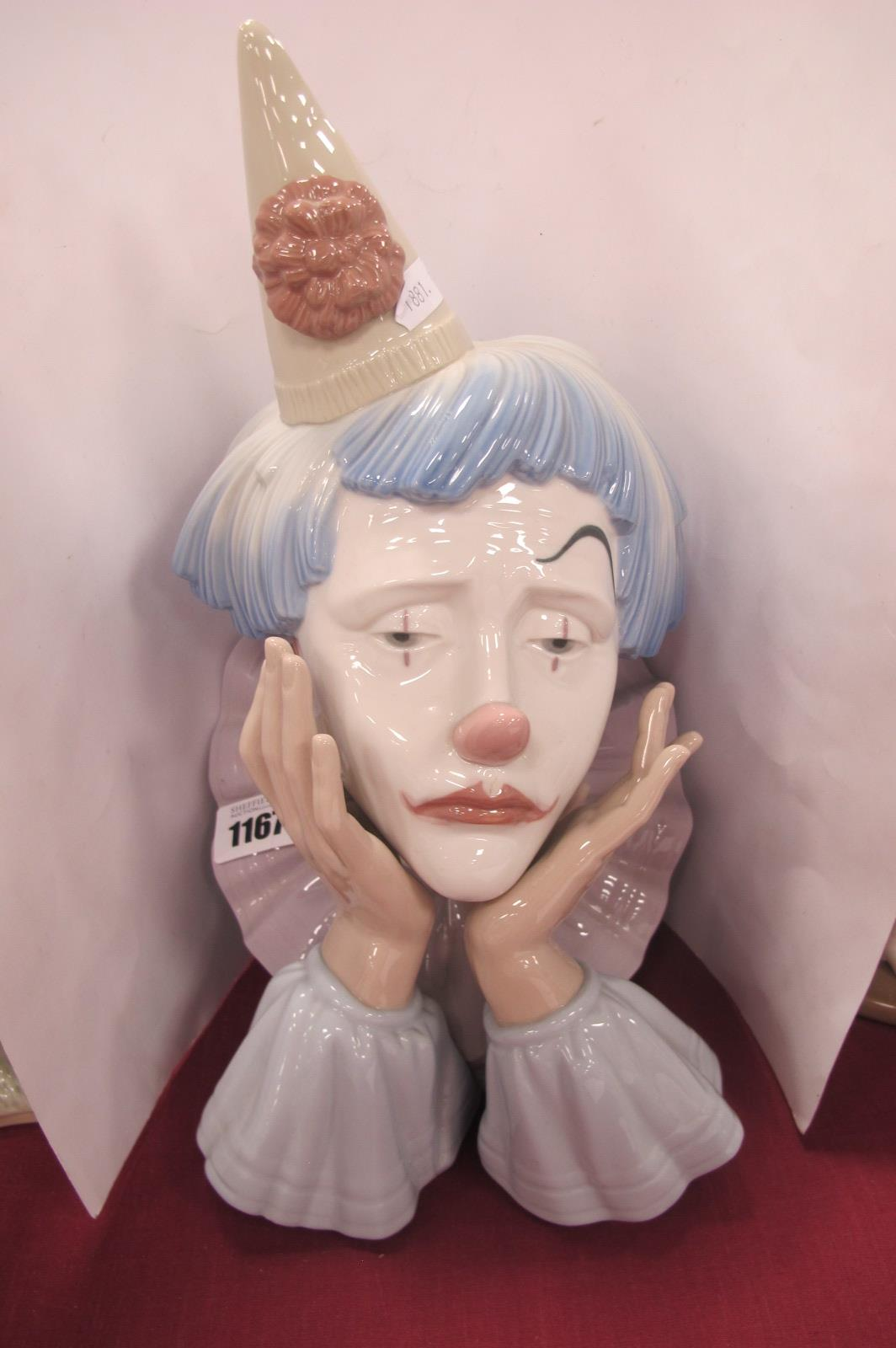 A Lladro Pottery Bust of a Sad Clown, with hands on face, stamped F-30 A, 30cm high.