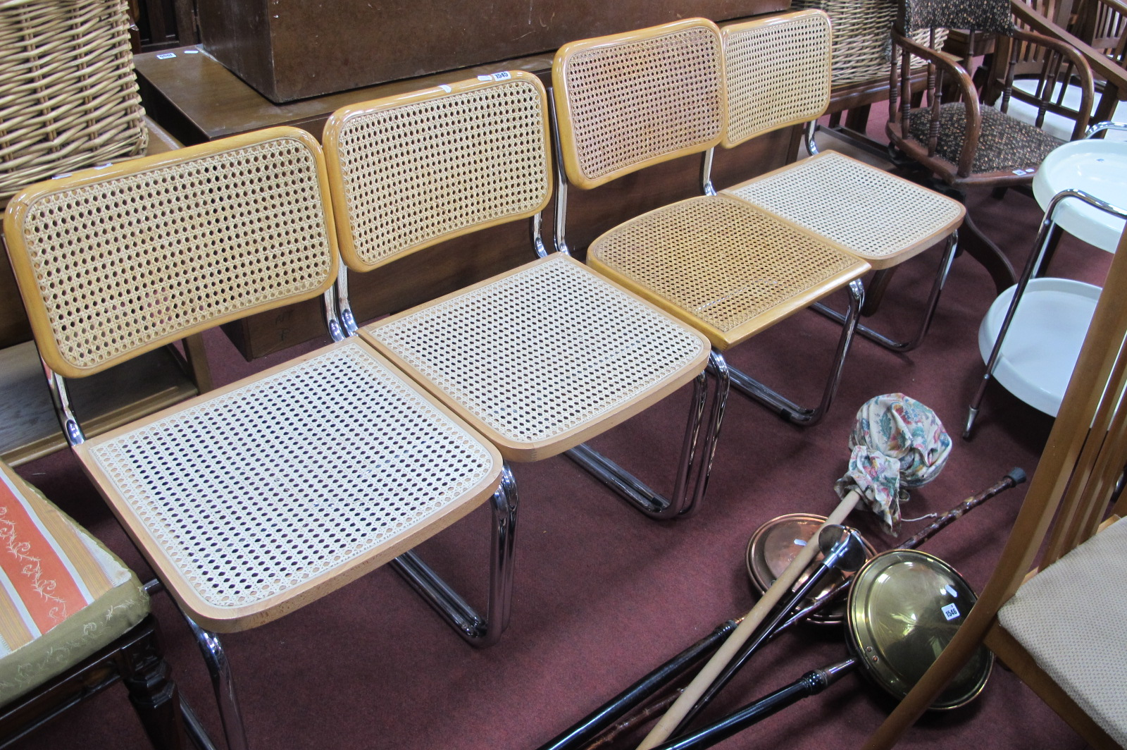 A Set of Four late 1960's Habitat Basket Weave Seat and Back chrome dining chairs.
