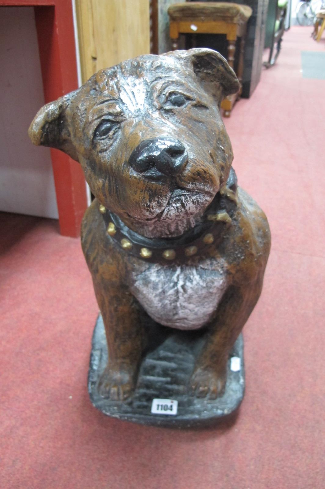 A Painted Concrete Door Stop, as a Staffordshire dog, 4.6cm high.