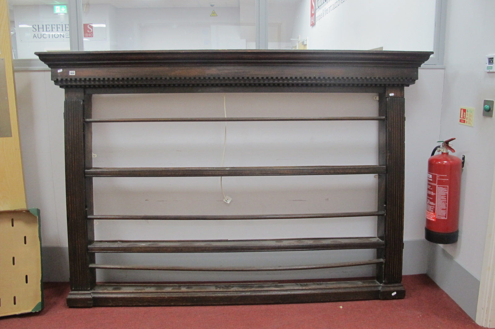 An XVIII Century Oak Dresser Rack, with dentil cornice, hinged and reeded sides, three shelves