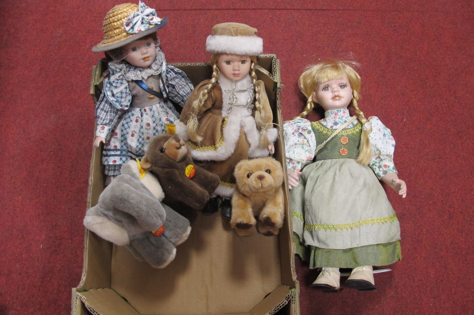 Steiff 'Cosy Jumbo', Steiff 'Browny' Bear, together with three dolls with porcelain heads, etc: