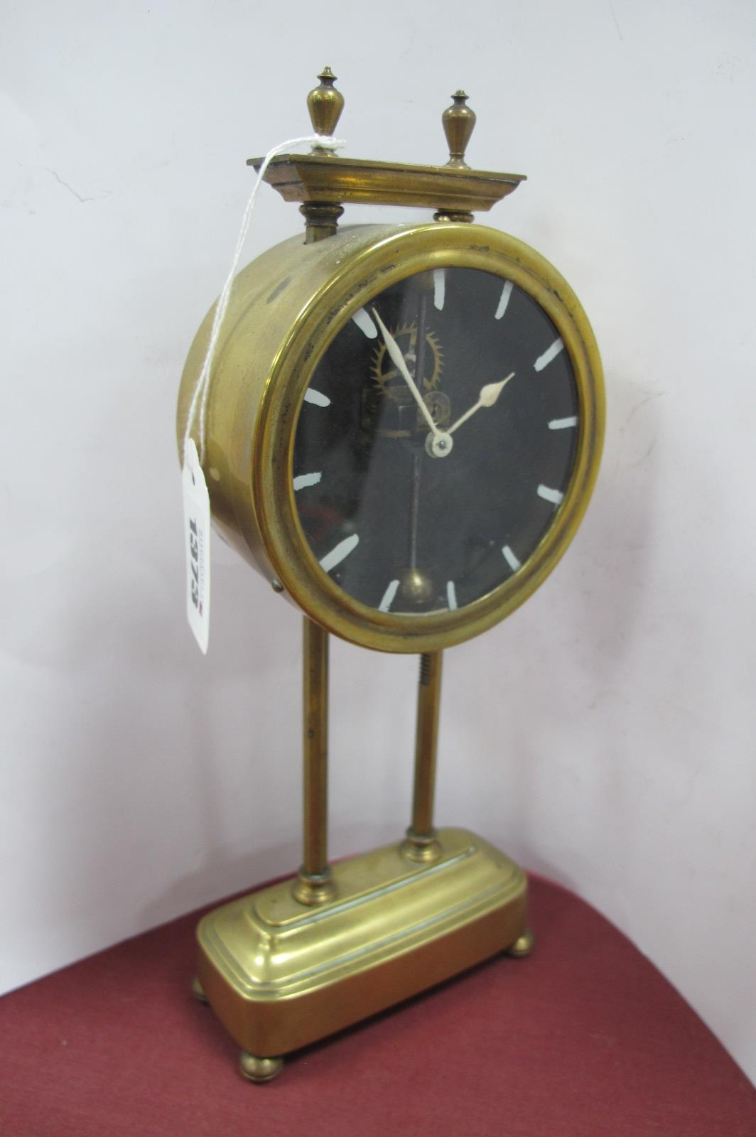 Gravity Clock, brass cased, numerals to dial absent, on twin hexagonal supports stamped 5541 and