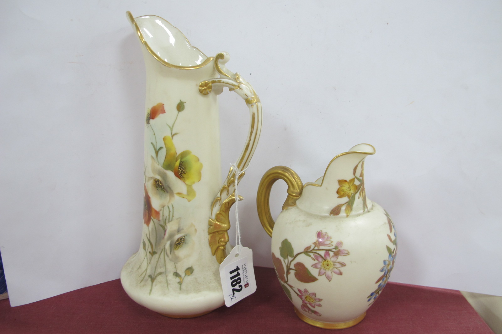 A Worcester Jug (Rd No 291151094) with a gilt handle decorated with flowers with red back stamp to