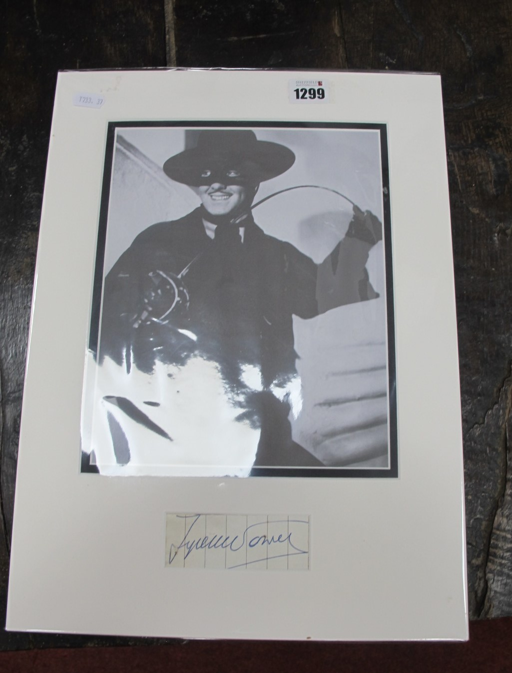Tyrone Power. Autograph, ink signed on paper, together with image of him as Zorro, mounted,