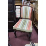 A Set of Four William IV Rosewood Chairs, with reeded top rails, upholstered centre panels and caned