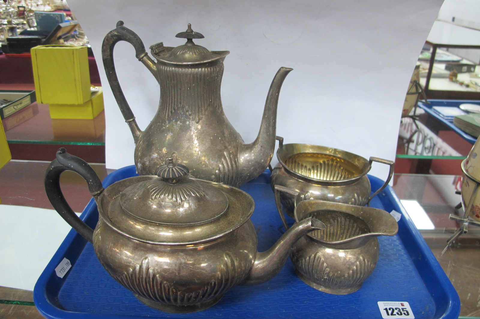 """An Elkington & Co Plated Four Piece Tea Set, each of oval semi reeded form, numbered """"15182"""". (4)"""