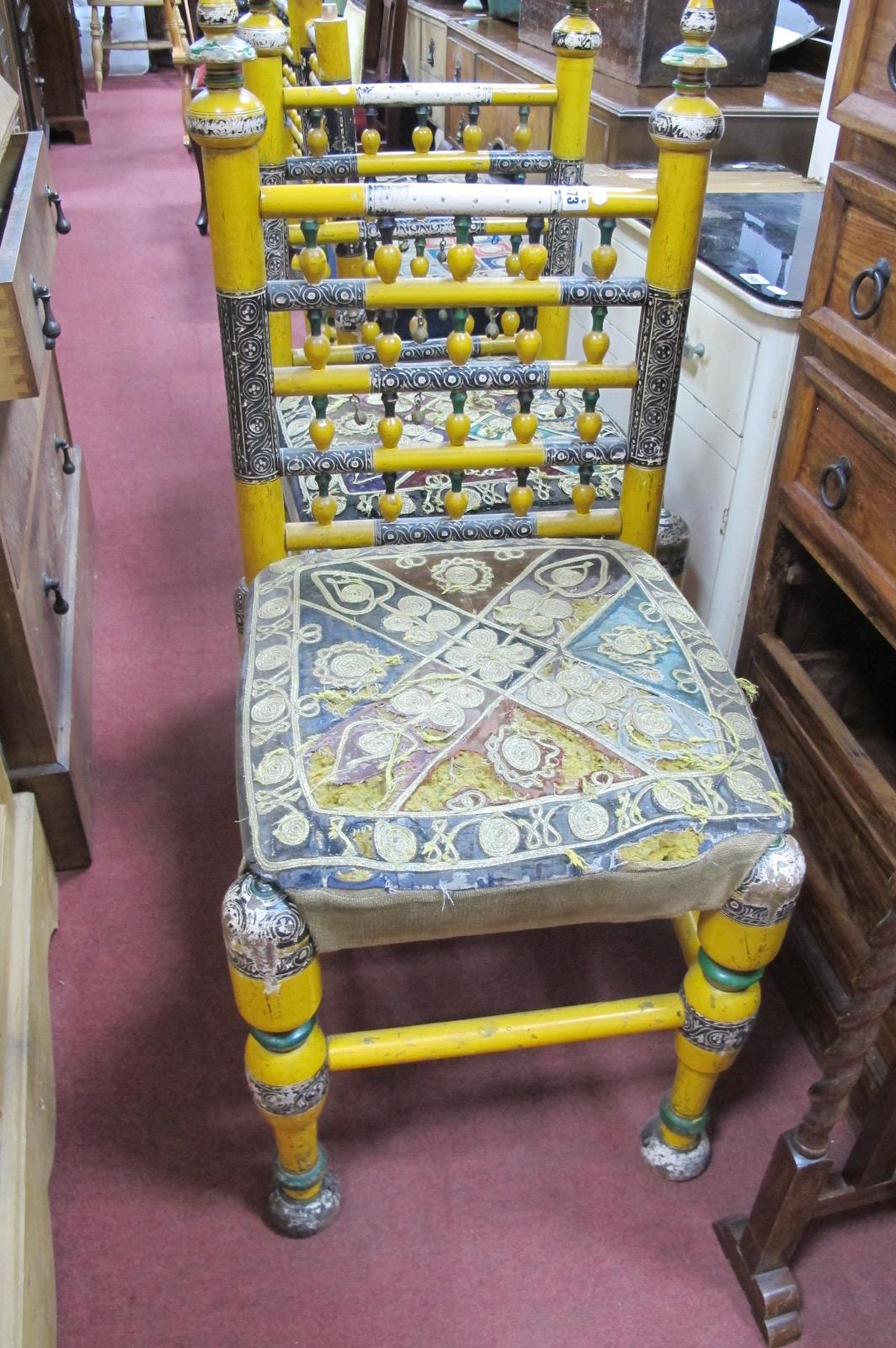 A Set of Four Indian Dining Chairs, yellow painted with braid to seats (damaged)