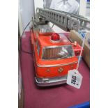 A Tine Plate Japanese Made Fire Engine, TM Trade Mark, remote control F.D No 9, 36cm long.