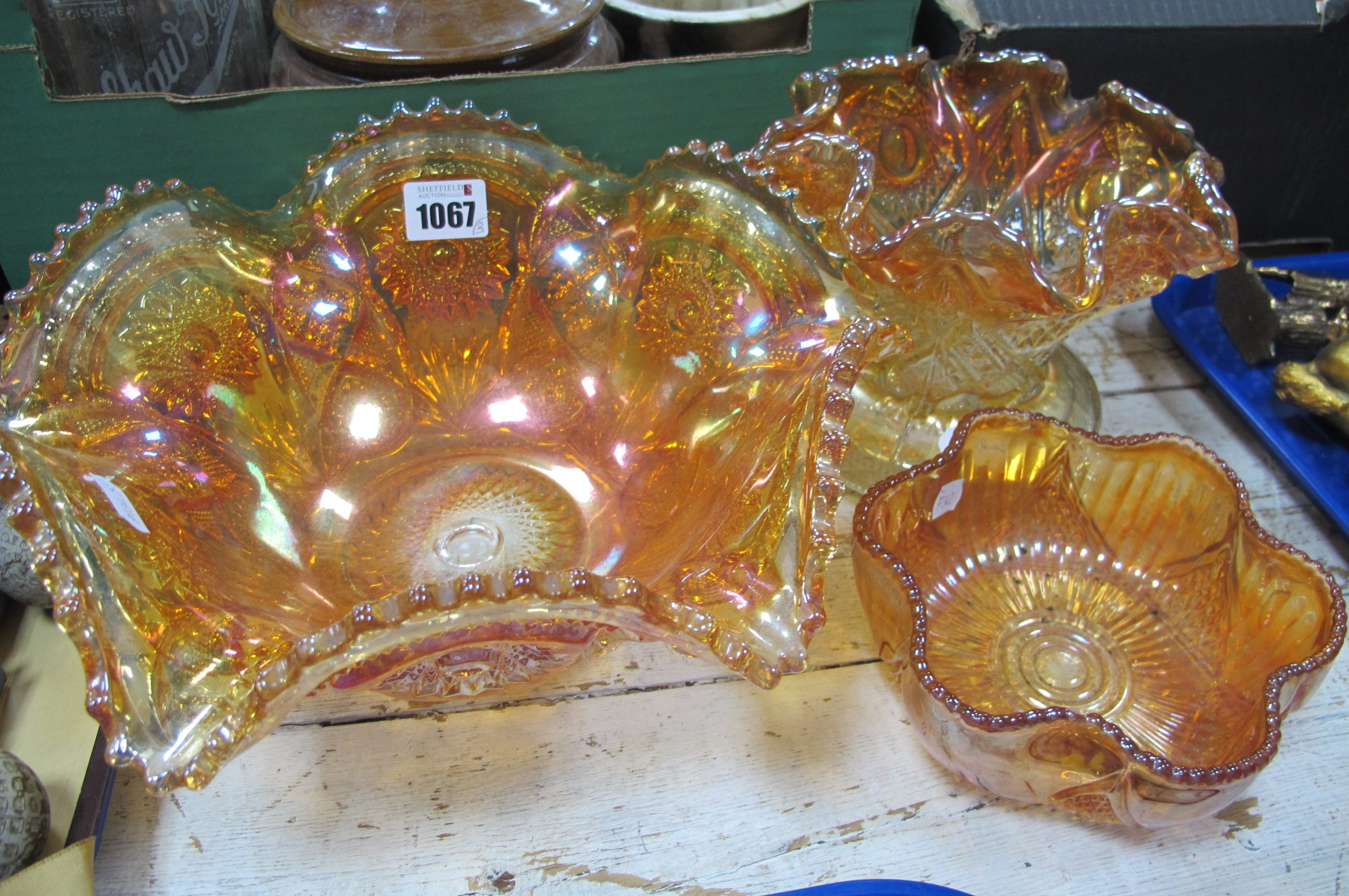 Carnival Glass, bowl with a wavy rim, together with two other Carnival glass bowls with wavy rims.