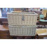 A Pair of Chairworks of Chelsea Bridge Wicker Baskets, 68cm wide, 27cm high, 43cm drop.