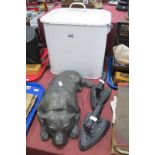 Concrete Door Stop as a Reclining Dog, 37cm long (damaged), two flat irons, enamelled bread bin. (