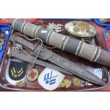 Military Two Bayonets, quiver, cap badges. patches, etc:- One Tray