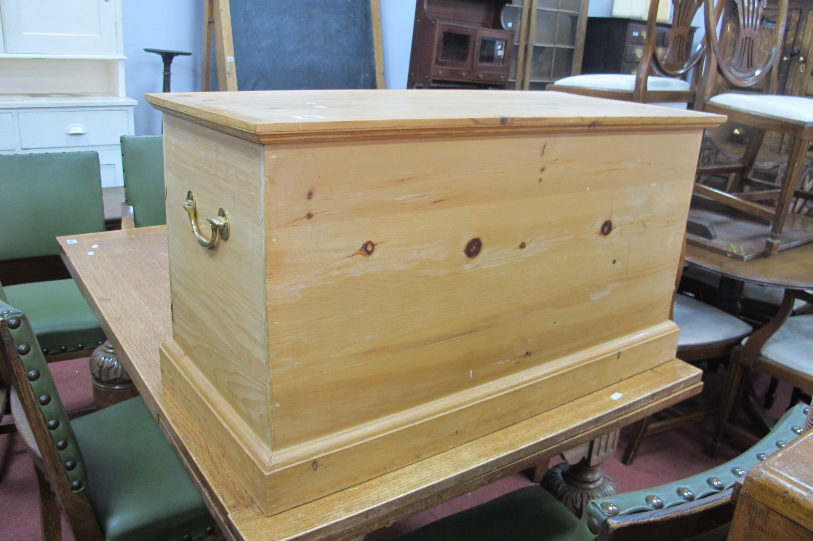 A Pine Blanket Box, with a hinged lid, on a plinth base, brass handles, 87 x 48cm.