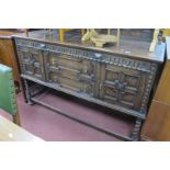 A 1920's Oak Sideboard in the Jacobian Manner, with three angular panels to back, the base with