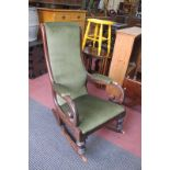 A XIX Century Mahogany Framed Rocking Chair, with scroll arm supports on turned legs, green dralon