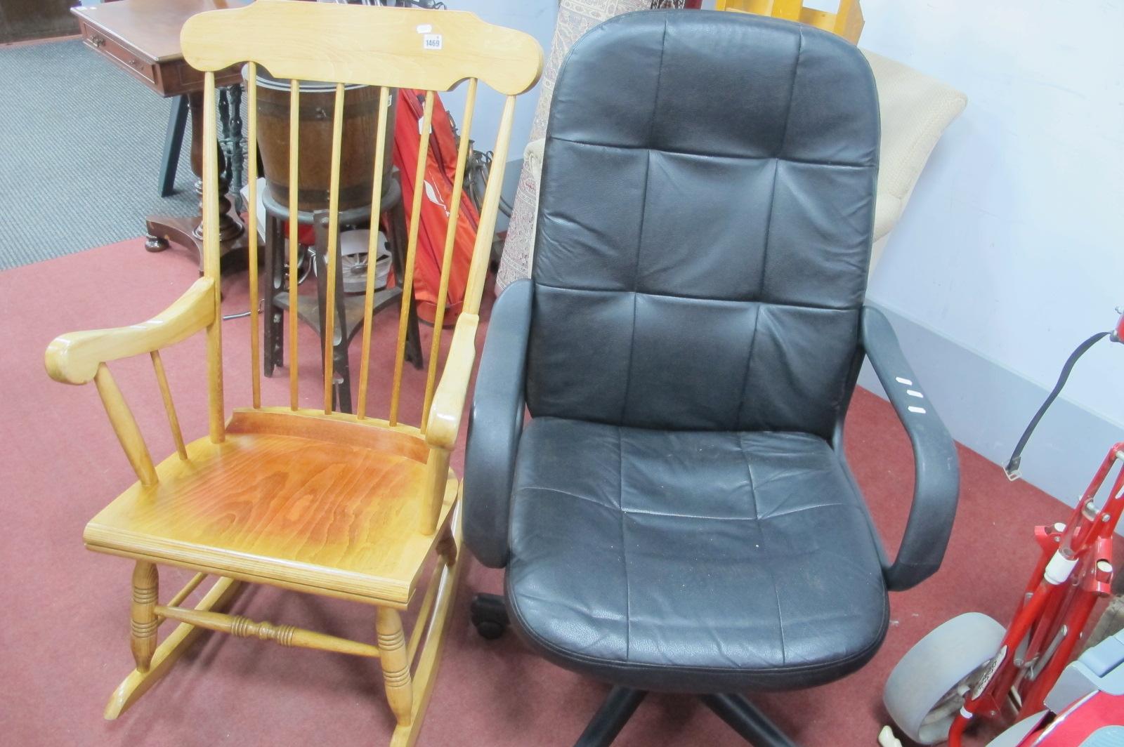 A Black Swivel Office Chair, on five star base, kitchen style rocker. (2)