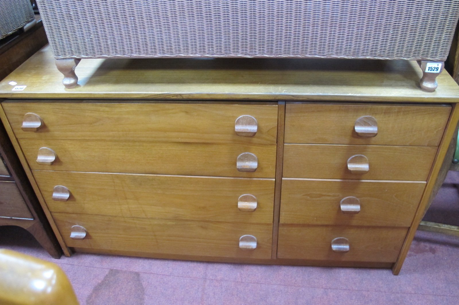 Stag Teak Chest of Four Long Drawers Aside Four Smaller, circa 1970's, having circular protruding