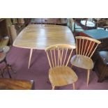 Ercol Blonde Drop Leaf Dining Table, on splayed legs, 111cm x opening to 122cm, a pair of curved