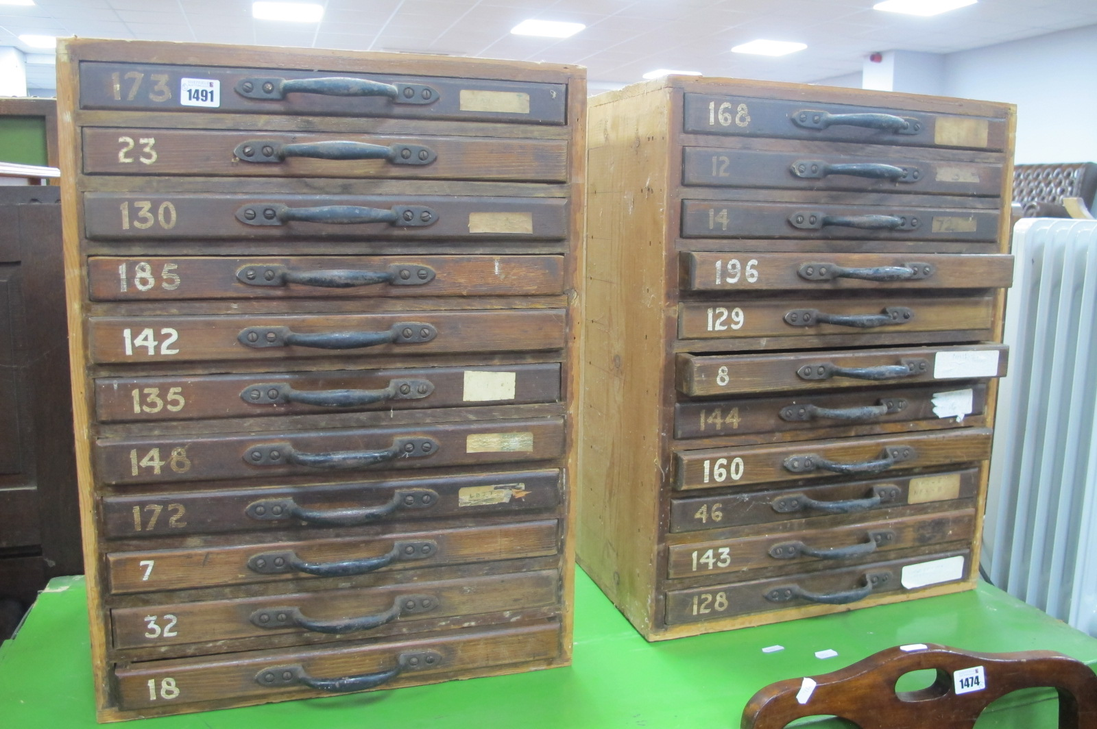 A Pair of XIX Century Pine Specimen Drawers, each having eleven drawers 60cm high 45.5cm wide. (2)
