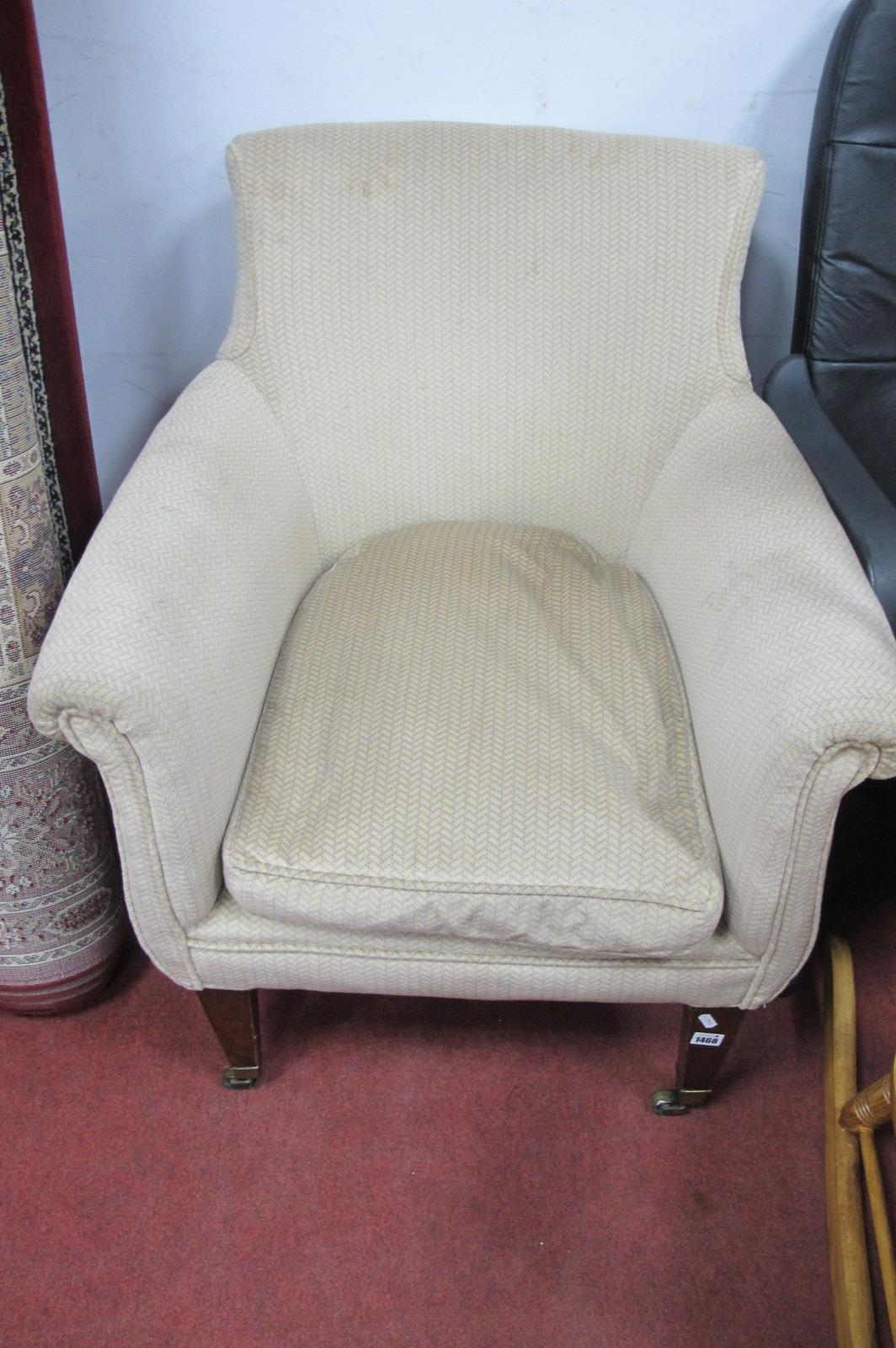 An Early XX Century Mahogany Famed Easy Chair, on tapering legs, later upholstered in pastel chevron