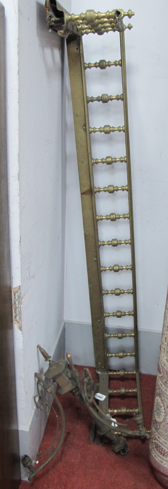 A XIX Century Brass Fender, with spindle supports, 153cm wide, plated early XX Century ceiling