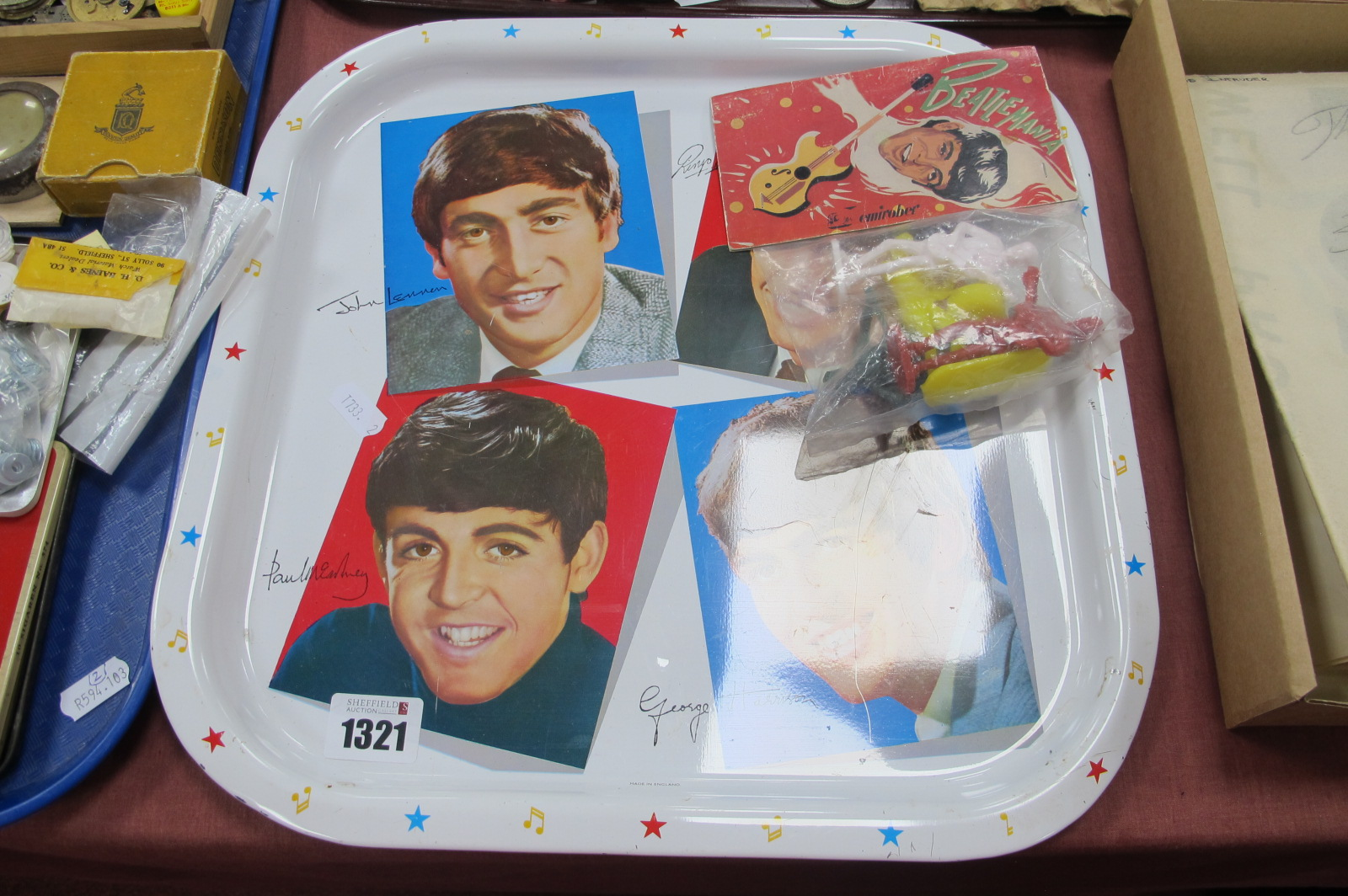 The Beatles, four plastic Beatlemania figures by Emirober in original packet, plus metal tray