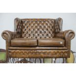 Leather Brown Button Back Two Seater Settee, with studded decoration.