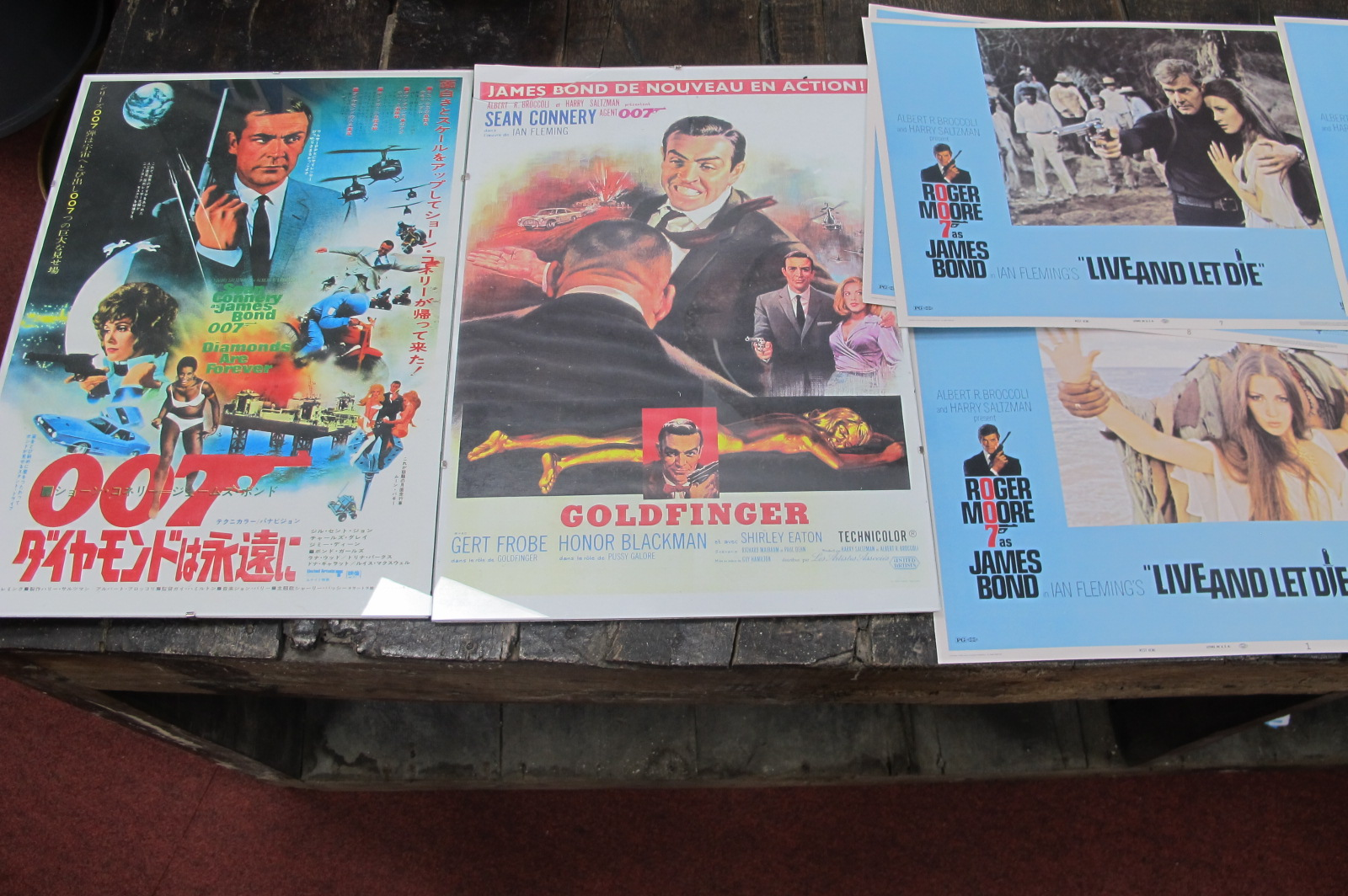 James Bond - two later posters featuring Sean Connery, 42 x 29.5cm, eight lobby cards featuring