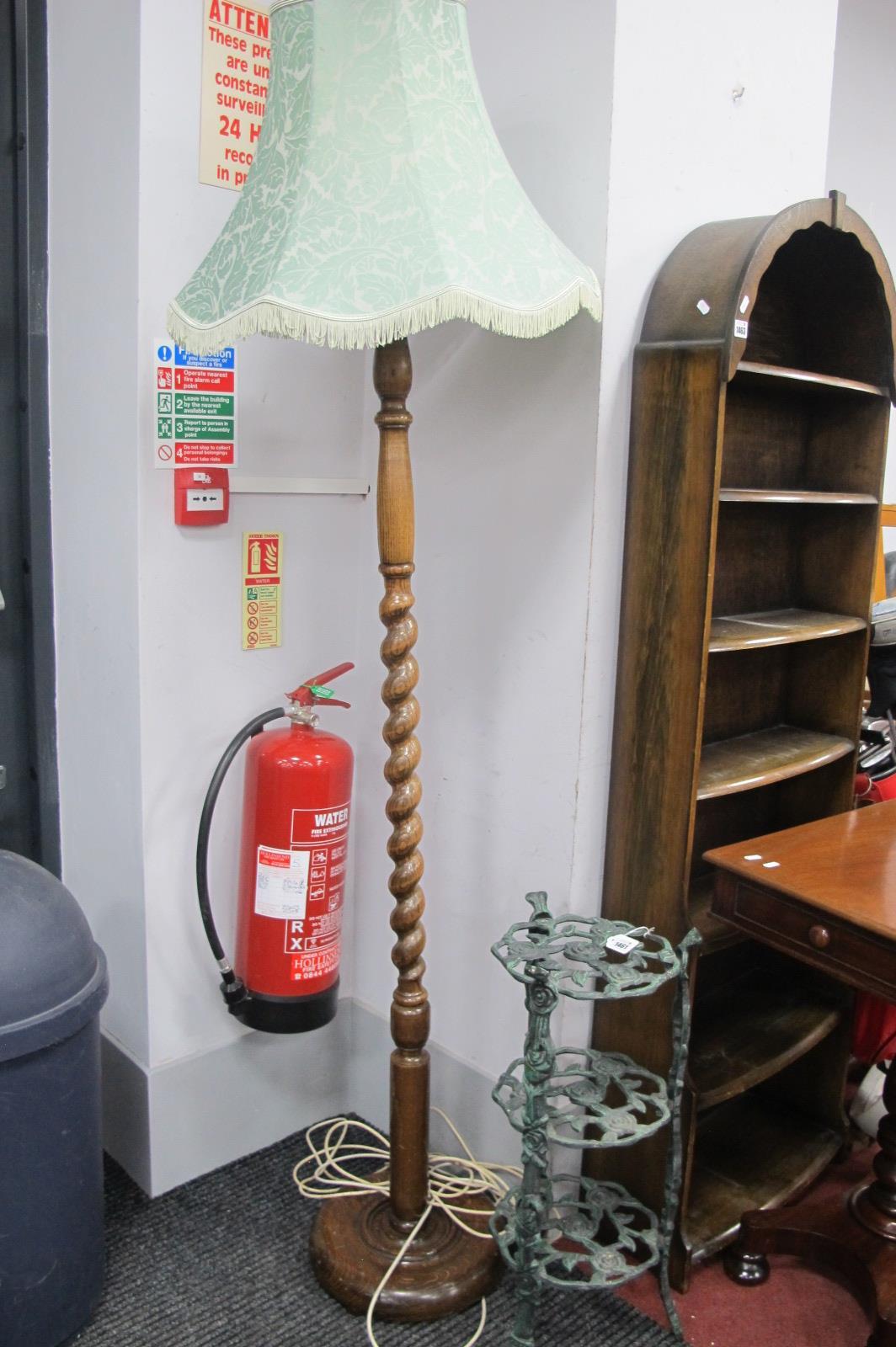 An Oak Barley Twist Table Lamp, on circular base, metal three tier stand, 66cm high. (2)