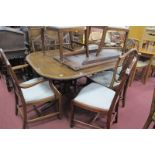 A Mahogany Dining Room Table, in the Regency manner with spare leaf 212cm wide, together with
