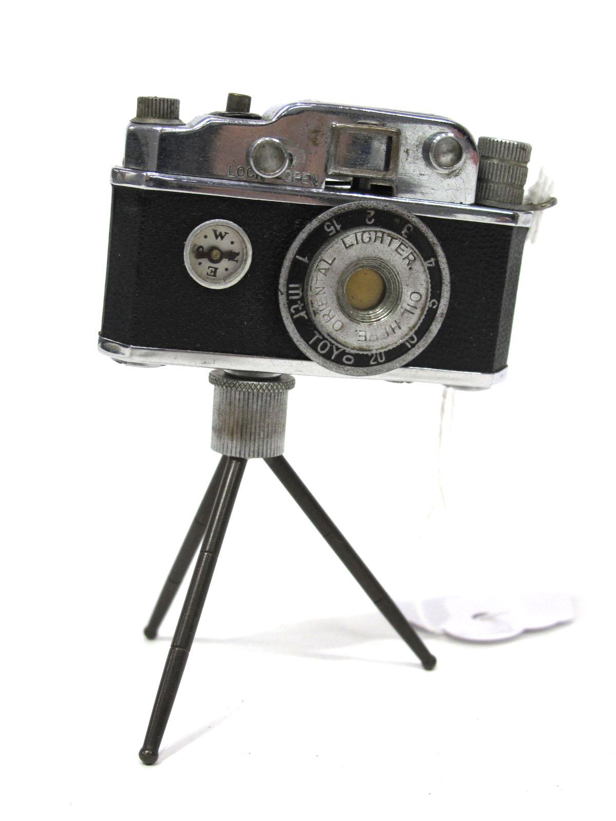 Camera Cigarette Lighter, on tri-pod with compass.