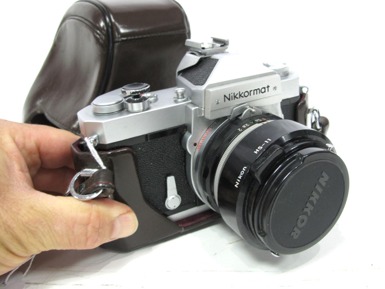Nikkormat Camera, with Nikkor f=50mm lens in brown leather case.