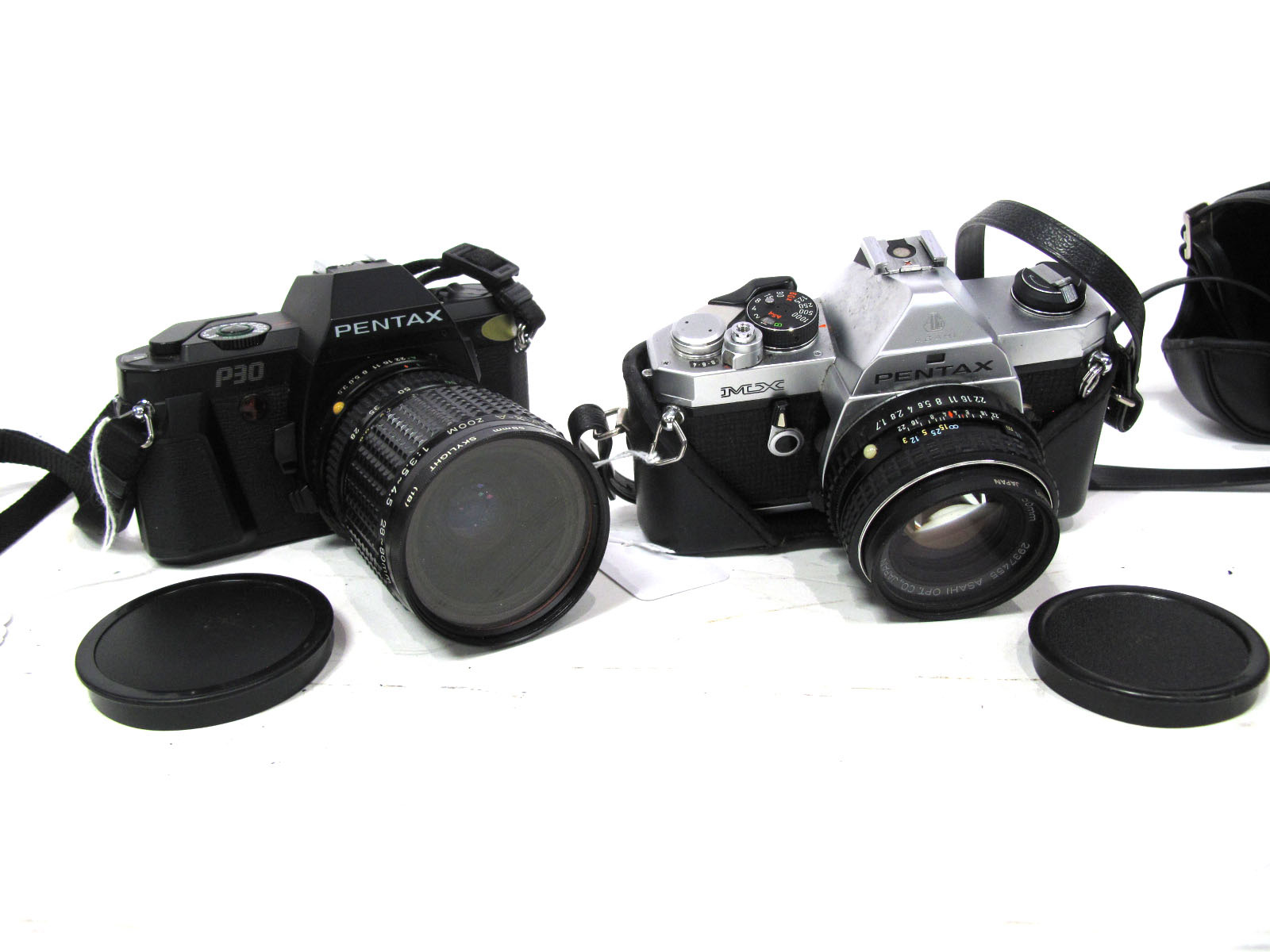 Pentax MX Camera, with SMC Pentax M 1-17 50mm lens and a Pentax P30 with SMC pentax-A Zoom 28-80mm.