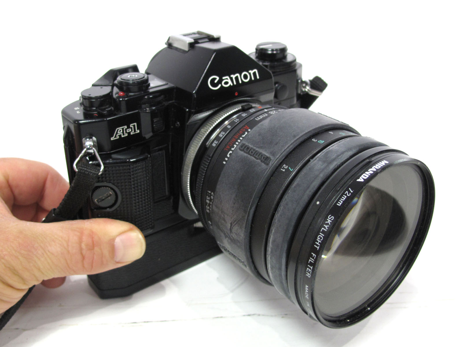 Canon A-1 Camera, with power winder, Tamron 28-200mm lens in black canvas case.