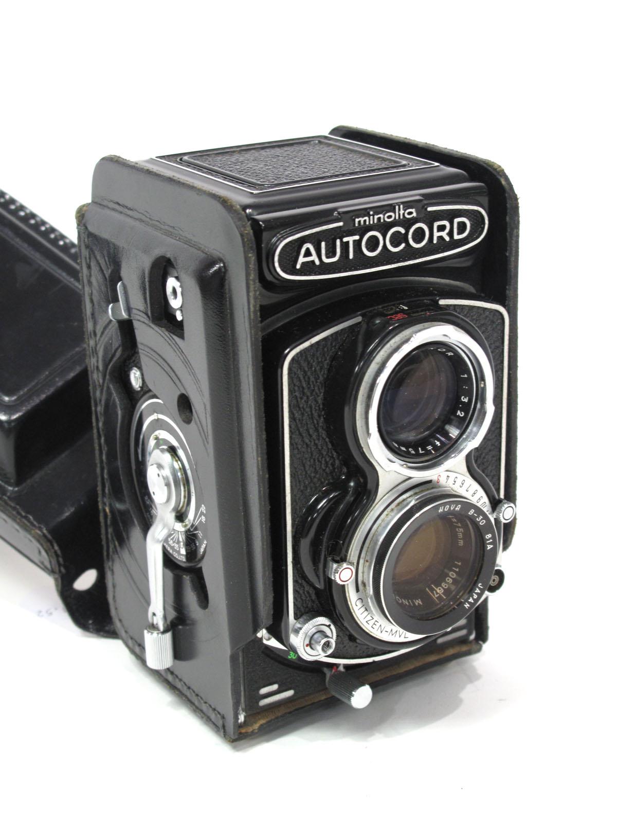 Minolta Autocord, Rokkor f=75mm lens in black leather case.