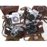 Zorki Rangefinder, plus three other camera's in leather cases. (4)