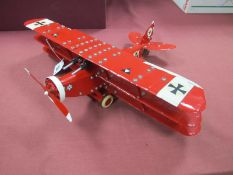 A Meccano Based Model of a German WWI War 'Red Barons' Tri-Plane, with twin guns, pilot. Finished in