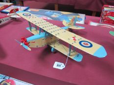 A Meccano Based Single Engines Bi-Plane, two pilots, finished in cream/light blue, fully
