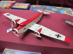 A Meccano Based Tri-Motor Passenger Aircraft, finished in cream/red with German insignia, fully