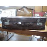 A Leather Suitcase, by J Bennett of Huddersfield, with P & O Cruise label to interior, 66cm wide.