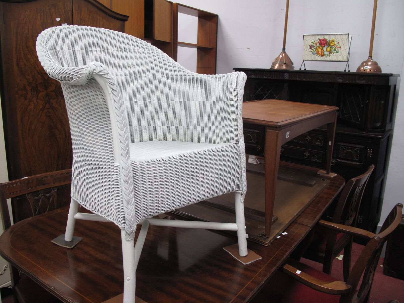 A Lloyd Loom Style White Painted Chair, together with a teak rectangular shaped coffee table (