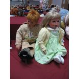 A Toddler Boy, indistinctly marked No. 112, 75cm high, and another toddler girl marked Celia GC 902,