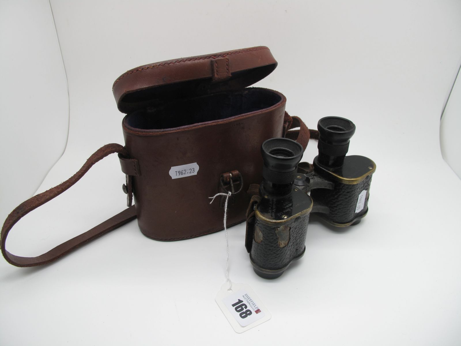 A WWI Era Pair British Military Binoculars, by W Withen? of London, worn in unassociated leather