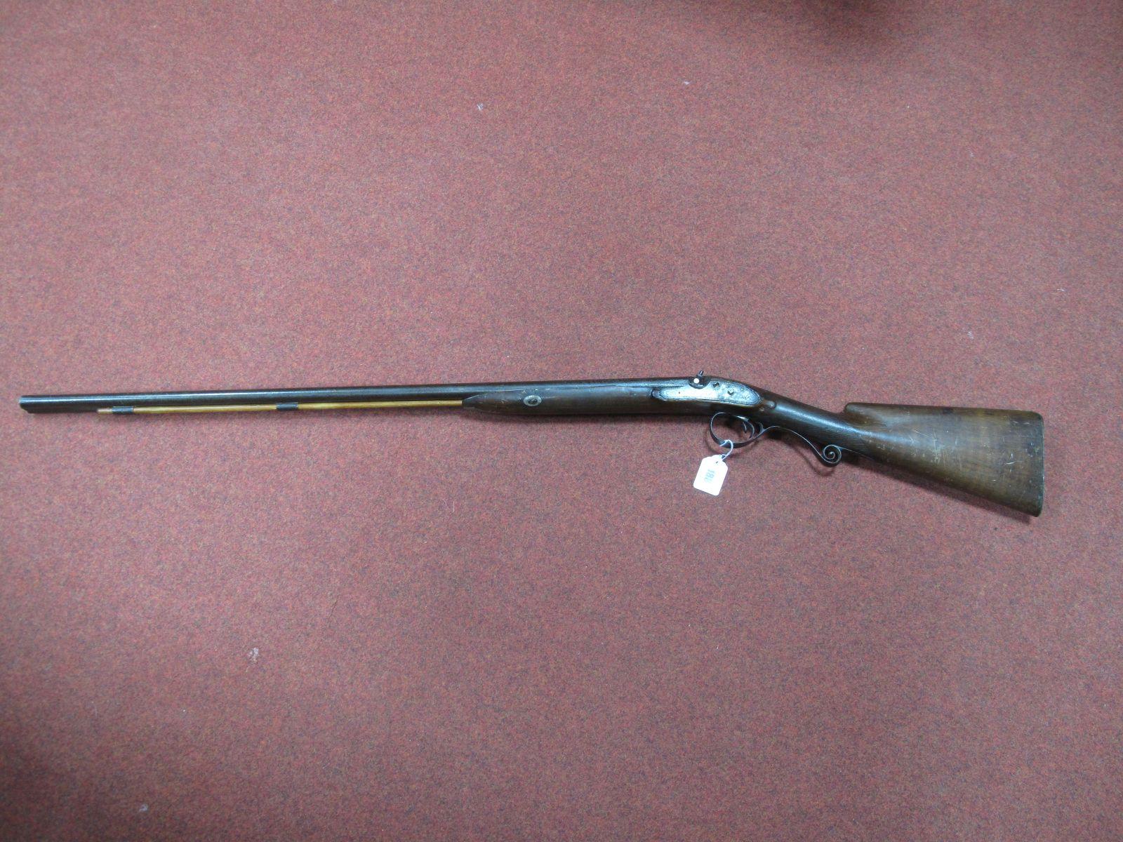 Remnants of a XIX Century Double Barrel Percussion Shot Gun.