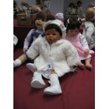 A Gotz Baby Girl Doll, impressed mark 682 and initials, 54cm high and two others indistinctly