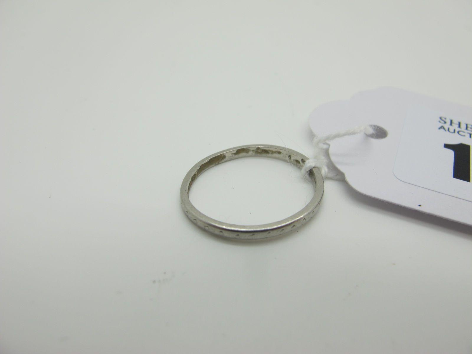 """A Plain Band, stamped """"Platinum"""" (finger size K) (1.8grams)."""