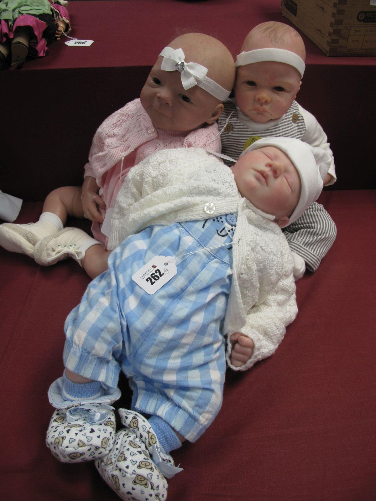 An Evelina Wosnjuk Baby Girl, 52cm high, a baby boy unmarked, 45cm high, and another baby girl by