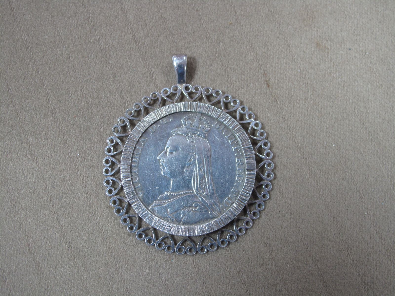 A 1890 GB Silver Crown, in a loose mount.
