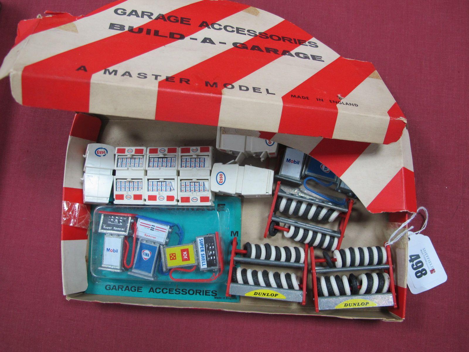 "Master Model Build A Garage, garage accessories, three petrol pumps in original pack, three ""Dunlop"""