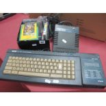 Amstrad 128K Colour Personal Computer, and Amstrad module MP-2, with a small quantity of games in
